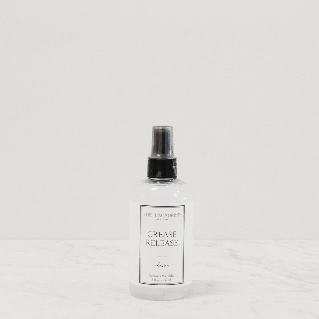 bottle of laundress crease and wrinkle release fabric spray scented in classic perfume