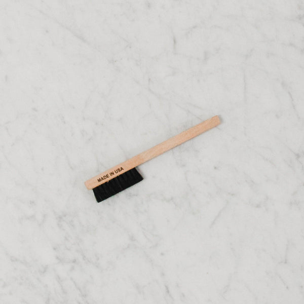 small stain scrubbing brush with black bristles made in the usa