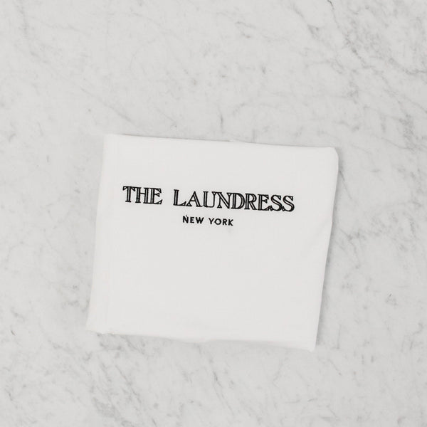 folded laundress hotel drawstring laundry bag for dirty laundry storage