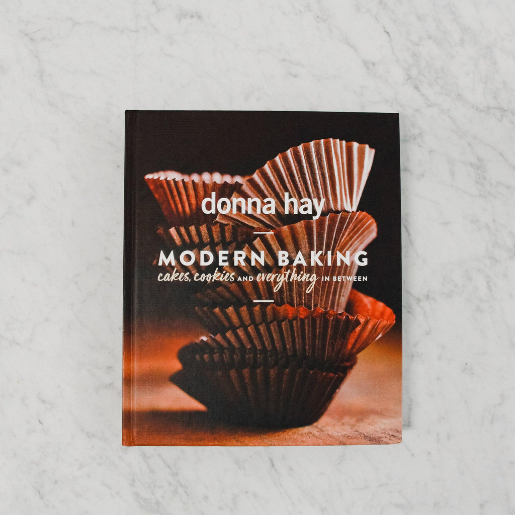 front cover of donna hay's modern baking. cover features stacked muffin cups