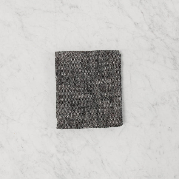 Top view of dark grey cotton kitchen towel