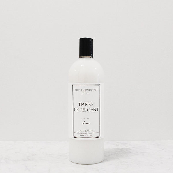 bottle of laundress darks detergent to prevent color fade