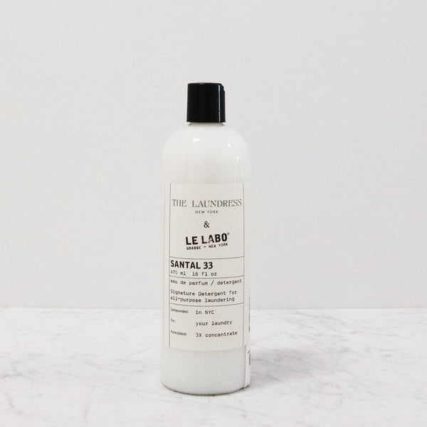 bottle of laundress le labo perfumed laundry detergent in santal 33