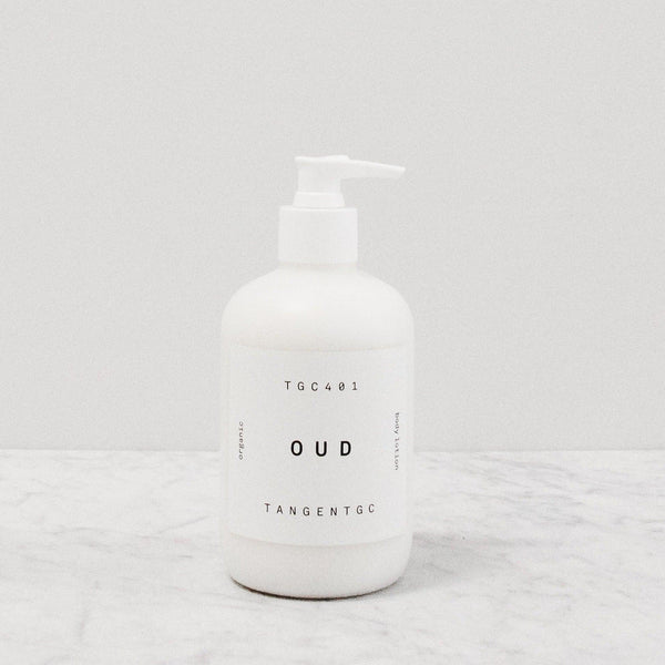Tangent GC Oud scented body lotion in a pump bottle