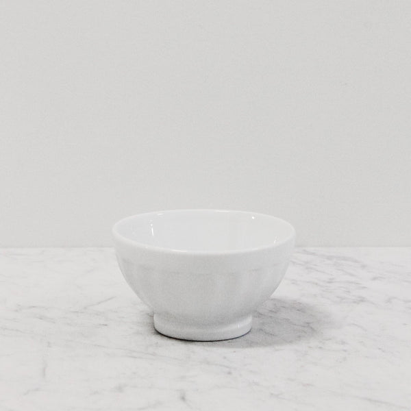 white fluted ceramic bowl