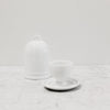 white tall ceramic butter dish with bell-like dome separated in two pieces to display inside