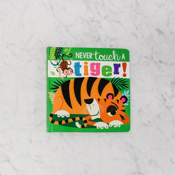 front cover of never touch a tiger