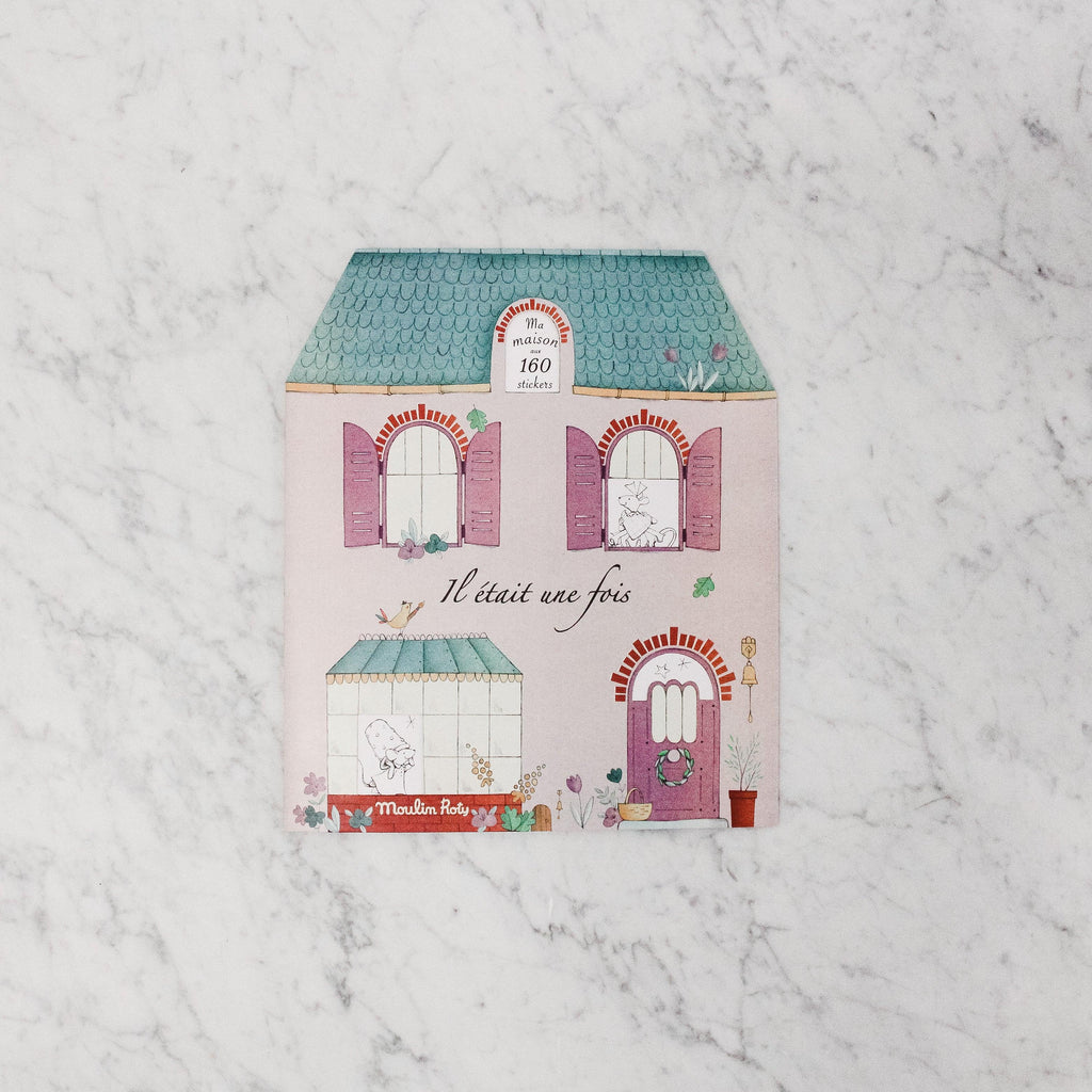 Moulin Roty ma maison (my house) sticker book in the shape of a french-style house.