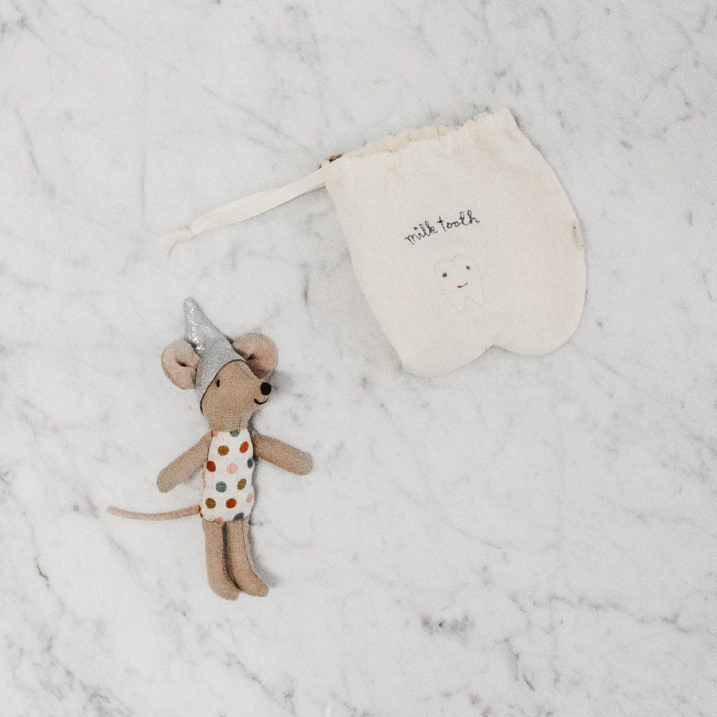 "Maileg tooth fairy mouse in a tooth-shaped draw string bag that is embroidered with the words ""milk teeth"""