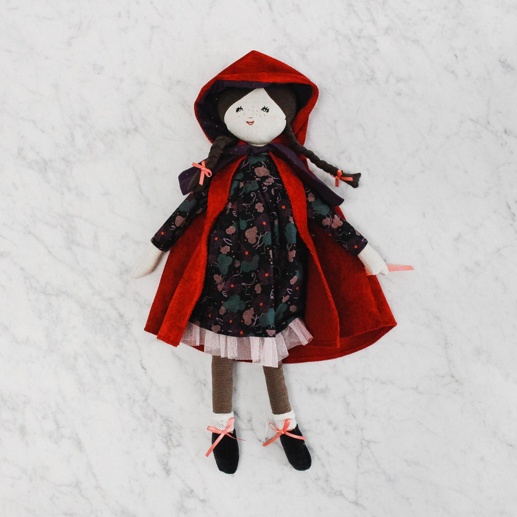 little red riding hood doll with red hooded jacket, dark green dress and pigtails