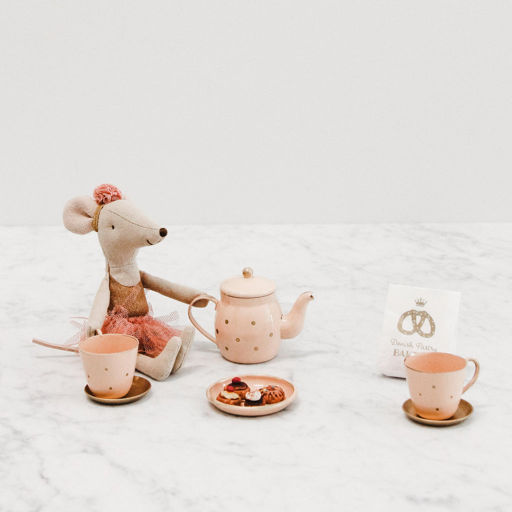 Maileg pink tea and biscuits set. Set included two metal teacups, one metal teapot, miniature pastries, a small metal serving platter and a miniature paper bag for pastries. Pictured with dancer mouse sold separately.