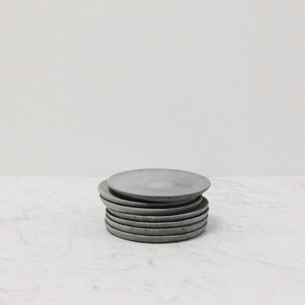 stack of small grey tone plates