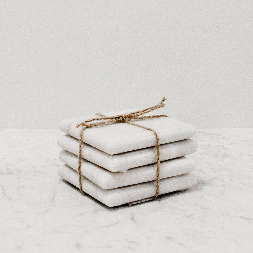 set of four white marble square coasters tied together with a string