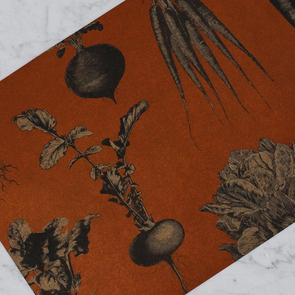dark orange placemat with root vegetables