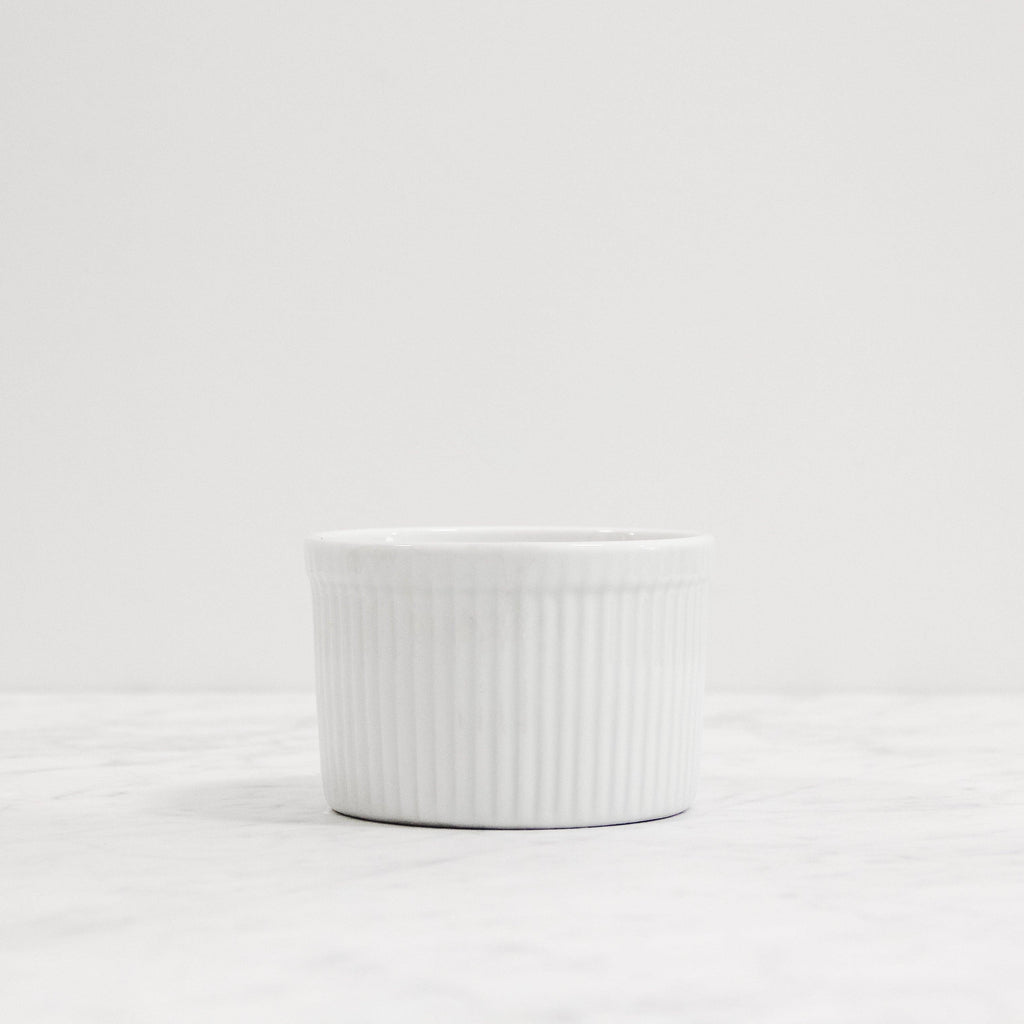 front view of small white french ramekin