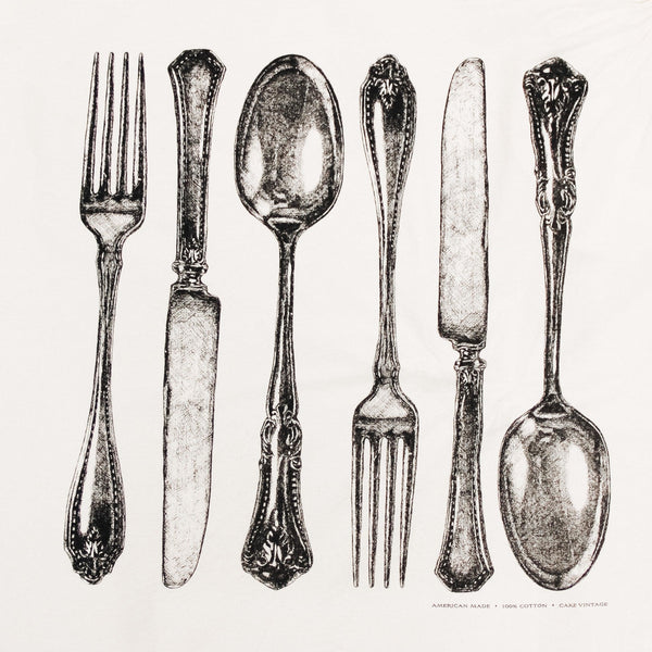 detail of hester and cook flour sack pattern. pattern depicts vintage looking knives, forks and spoons in black and white