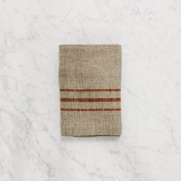 Natural coloured tea towel with three dark red horizontal stripes