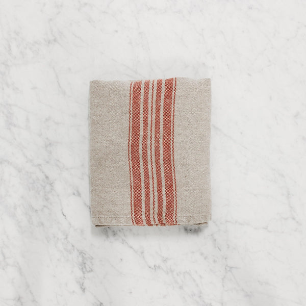 folded linen way maison tea towel natural with red stripe