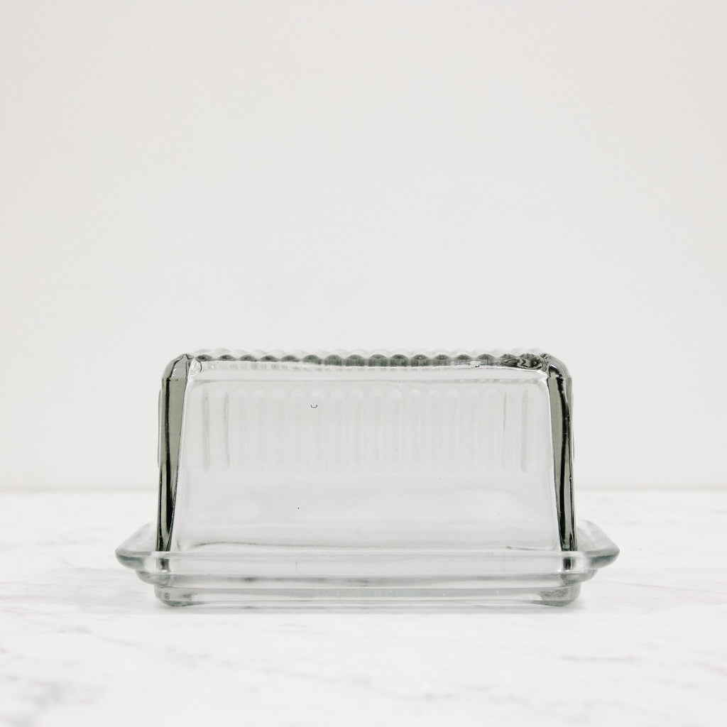 a clear glass rectangular butter dish