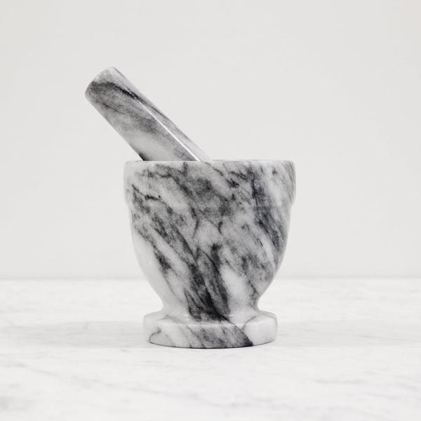 tall grey marble mortar and pestle