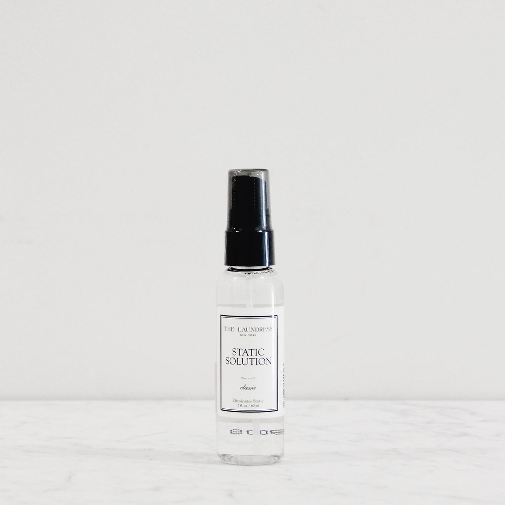 travel sized bottle of the laundress static solution in classic scent