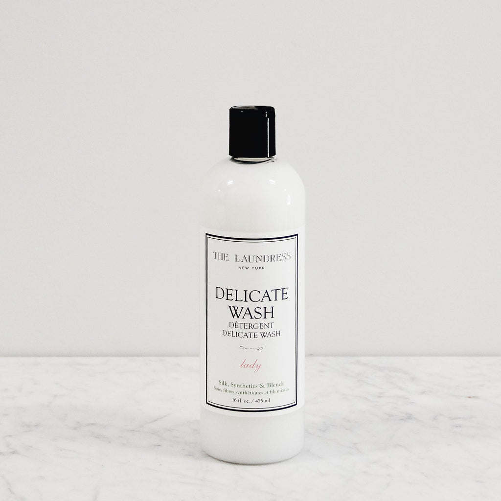 bottle of laundress delicate wash detergent scented in feminine parfume