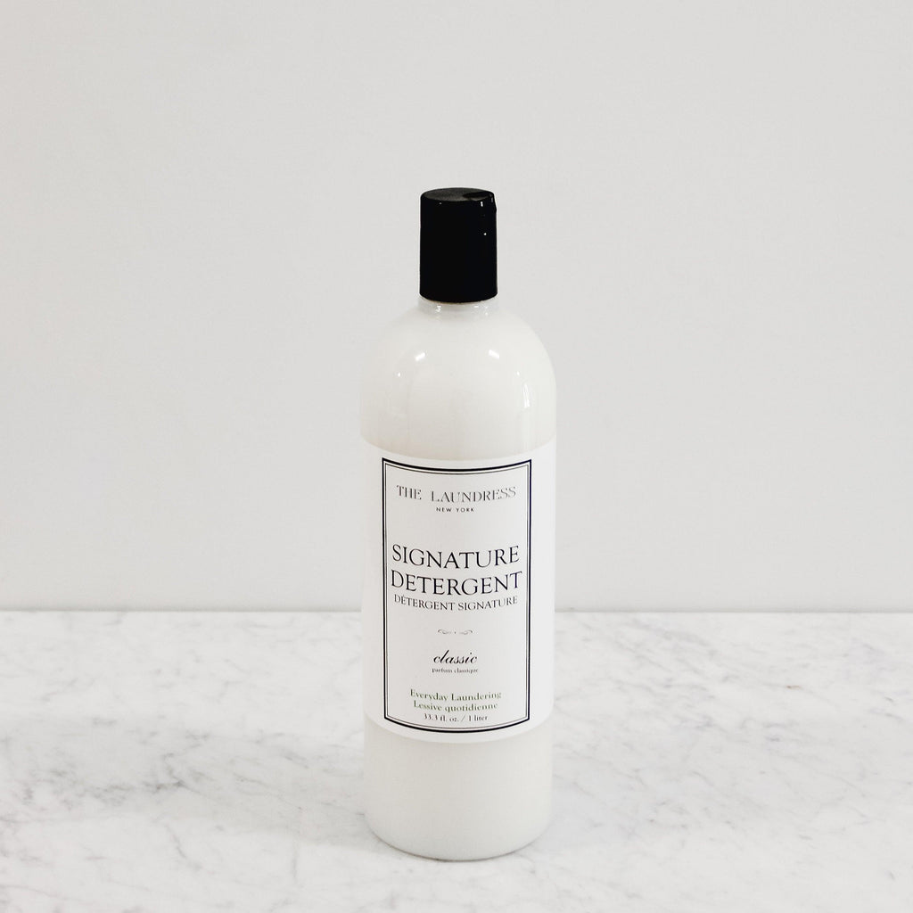 bottle of laundress signature detergent scented in classic perfume