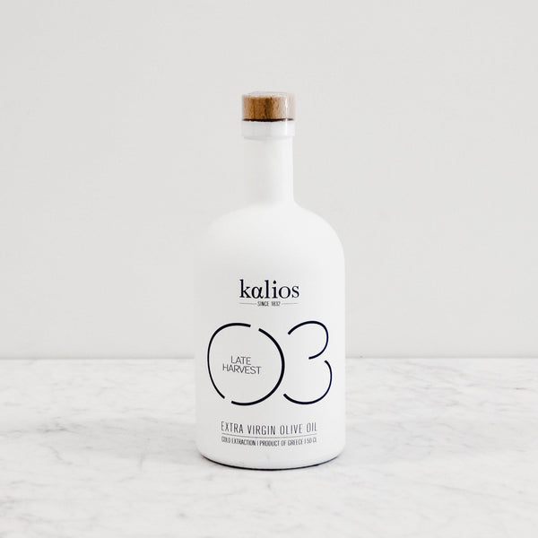 kalios late harvest extra virgin olive oil in a white glass bottle