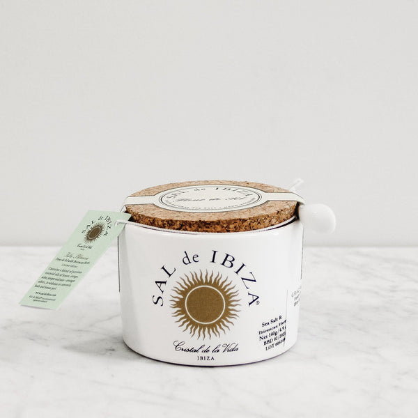 white and gold jar of fleur de sel with cork lid