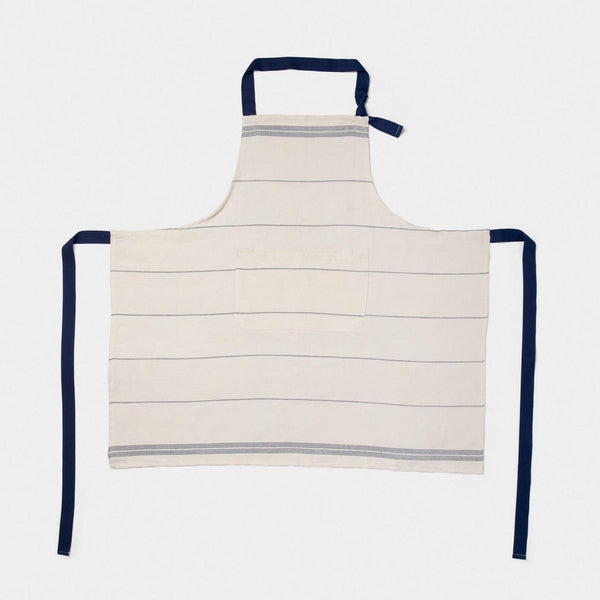 Product shot of Falcon enamelware Natural apron with navy blue thin horizontal stripes and navy ties
