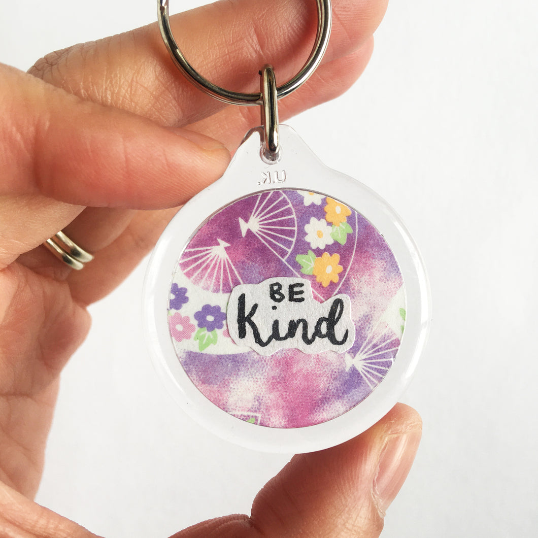 Handwritten and handcut motivational papercut keyring