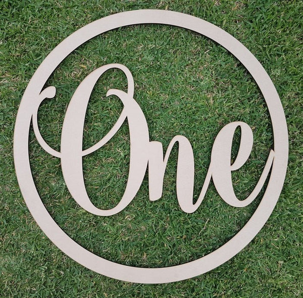 """One"" large wooden sign"