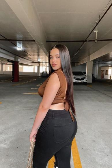 We are so excited  our BEST SELLER Erika Mesh  Crop Top in coffee brown is back in stock. This crop top features a drape detail & bust detail.  Complete the look with our Alyssa wide leg jeans , Lola luxury sunglasses and Ella pleated shoulder bag for a date night look.