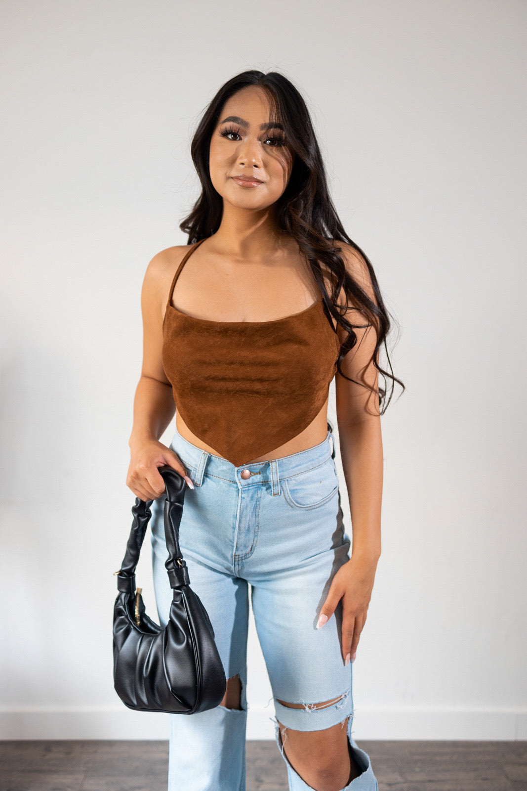 We are in love with our  best seller Jade corduroy crop top in a new color brown. This is a mini soft corduroy scarf style  crop top featuring open tie back with very good stretch. Complete the look by paring it up with our Alyssa wide leg jeans & Ella pleated shoulder bag.