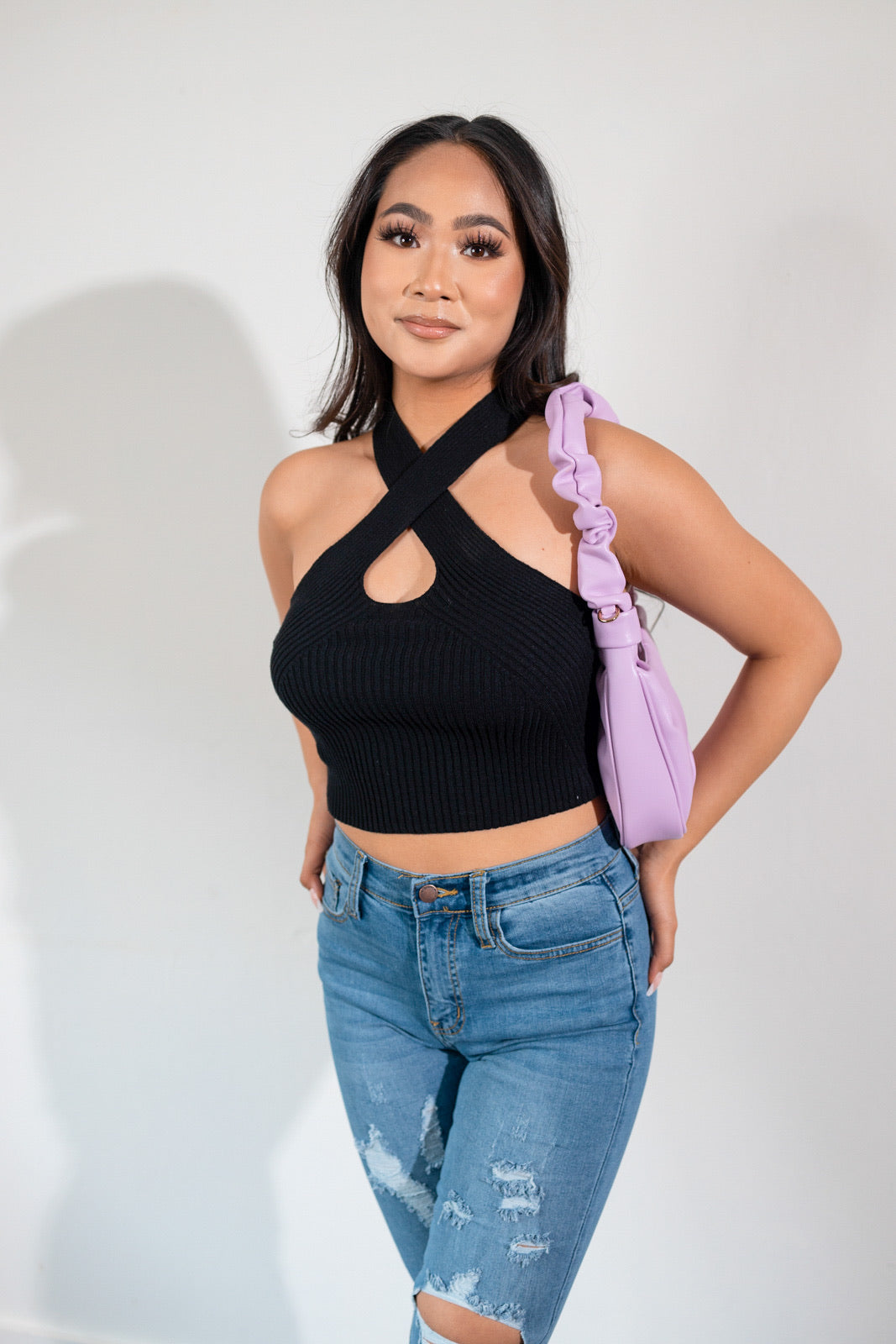 We are obsessing over our best seller Snow knit crop top in a new color black.  This is a knit halter top  with a keyhole detail. Cropped top has a good stretch and is very soft. Complete the look with our Malika distressed jeans and our Ella pleated shoulder bag.