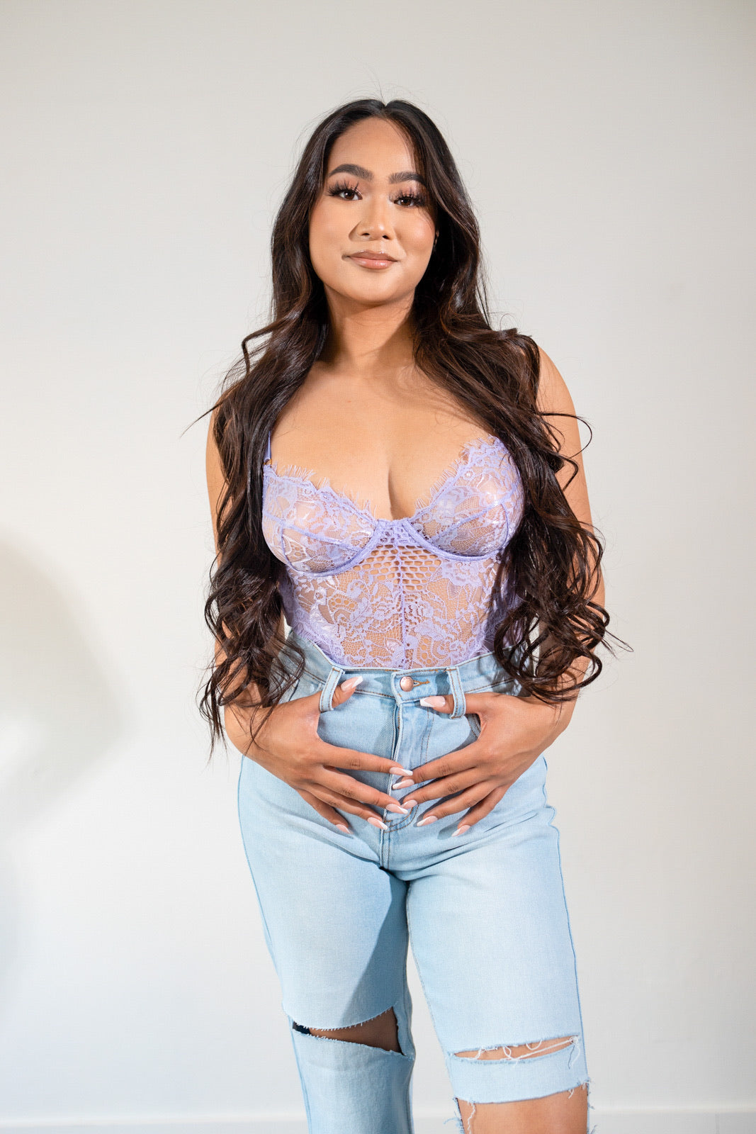 The Brielle Mesh Bodysuit in lavender is the perfect top to pair with jeans for a cute date night look. This bodysuit features underwire , adjustable straps, stretch, hook and eye closure. Bodysuit has no lining in cups.