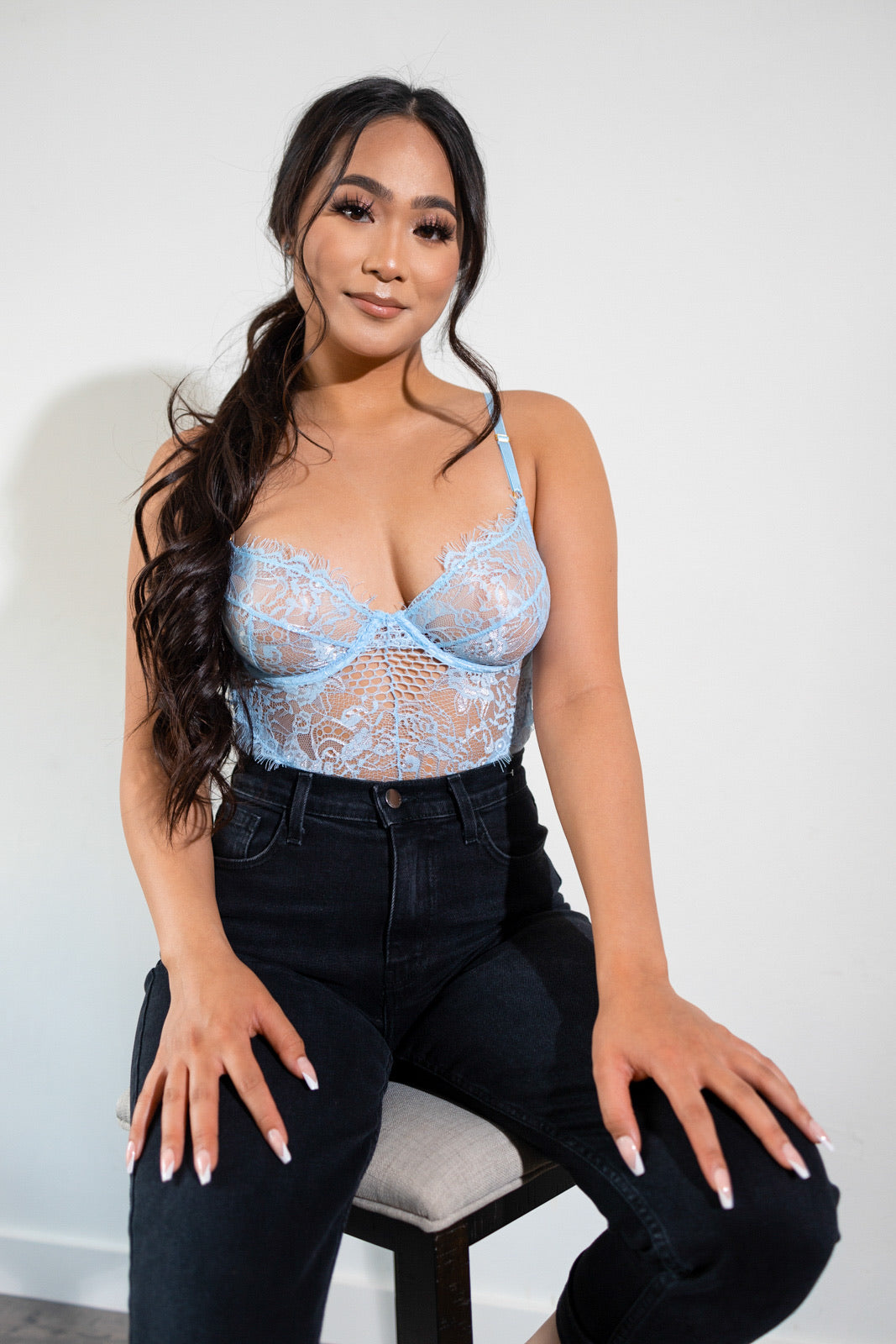 The Brielle Mesh Bodysuit in blue is the perfect top to pair with jeans for a cute date night look. This bodysuit features underwire , adjustable straps, stretch, hook and eye closure. Bodysuit has no lining in cups.