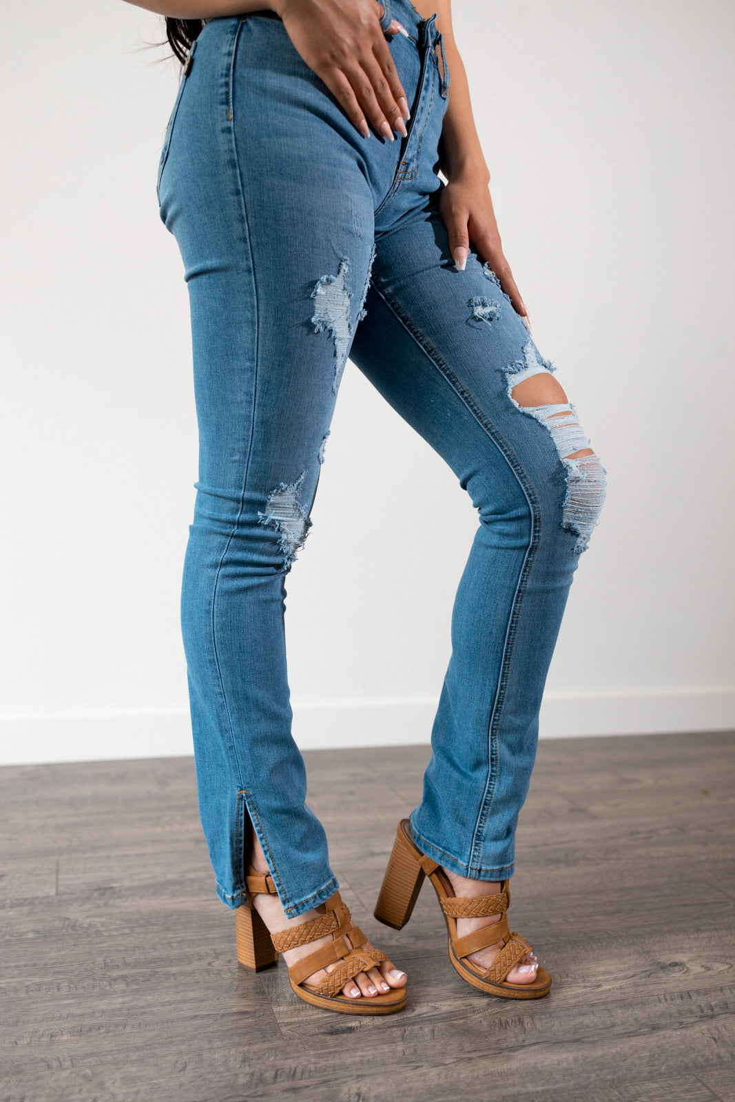 The Malika Distressed Jeans in dark wash blue denim is a must have for any wardrobe. These skinny high waisted jeans features a bootcut slit , distress throughout , 5 pockets design, belt loops and button closure. Complete the look with our Dove crop top or any of our tops.    51% Cotton 34%Viscose 14% Polyester