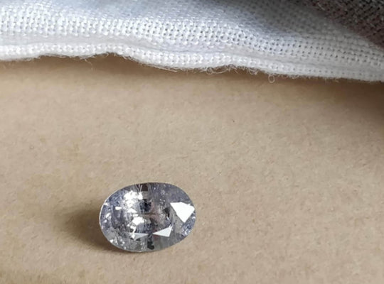 ~1.10 ct Oval Purple/Grey Included Sapphire