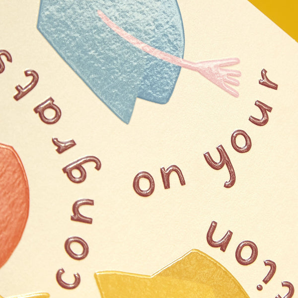 Colourful mortarboard 'congrats on your graduation' card