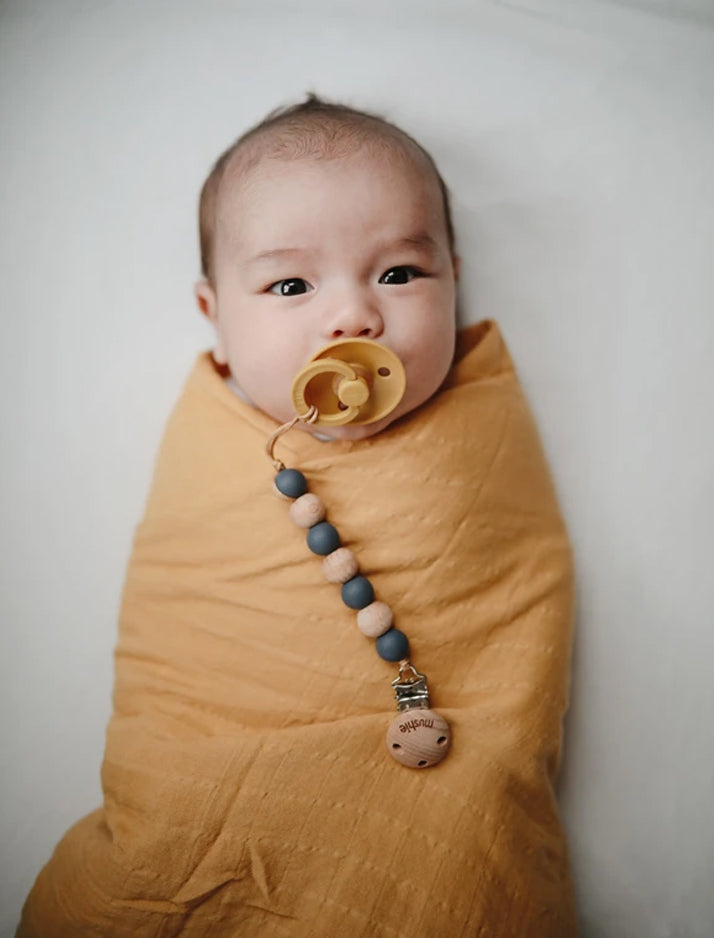 Mushie | Organic cotton muslin swaddle blanket (rainbows)