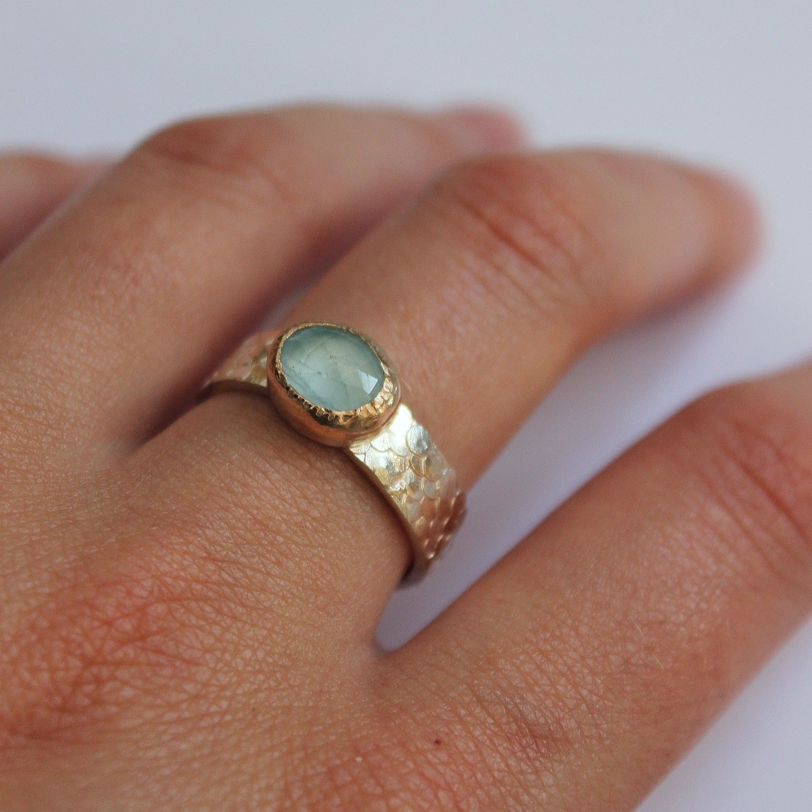 Hand crafted Aquamarine ring made with silver and 9 ct gold. The ring features Josie's signature Siren detailing around the band. March birthstone jewellery.