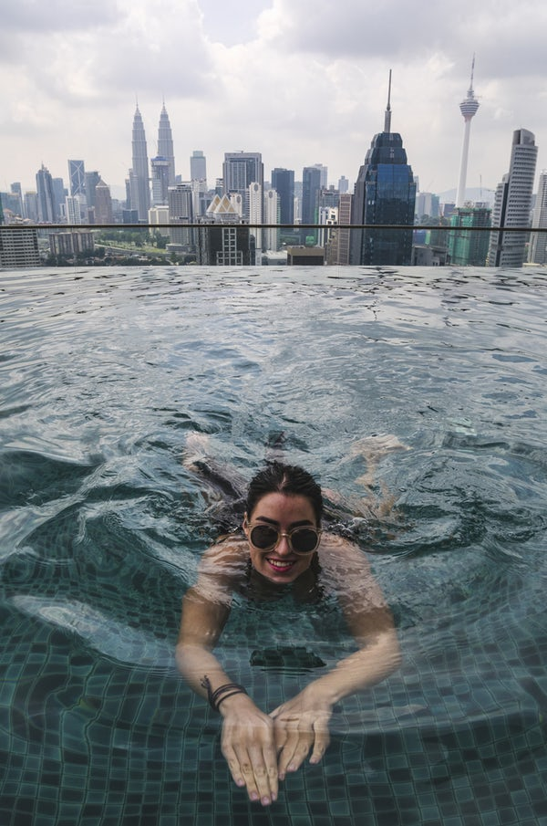 woman_swimming_with_city_skyline