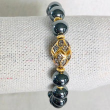Load image into Gallery viewer, Hematite And Gold Diamond Bracelet