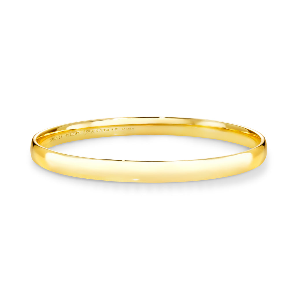 9ct Yellow gold silver filled bangle 6mm wide.