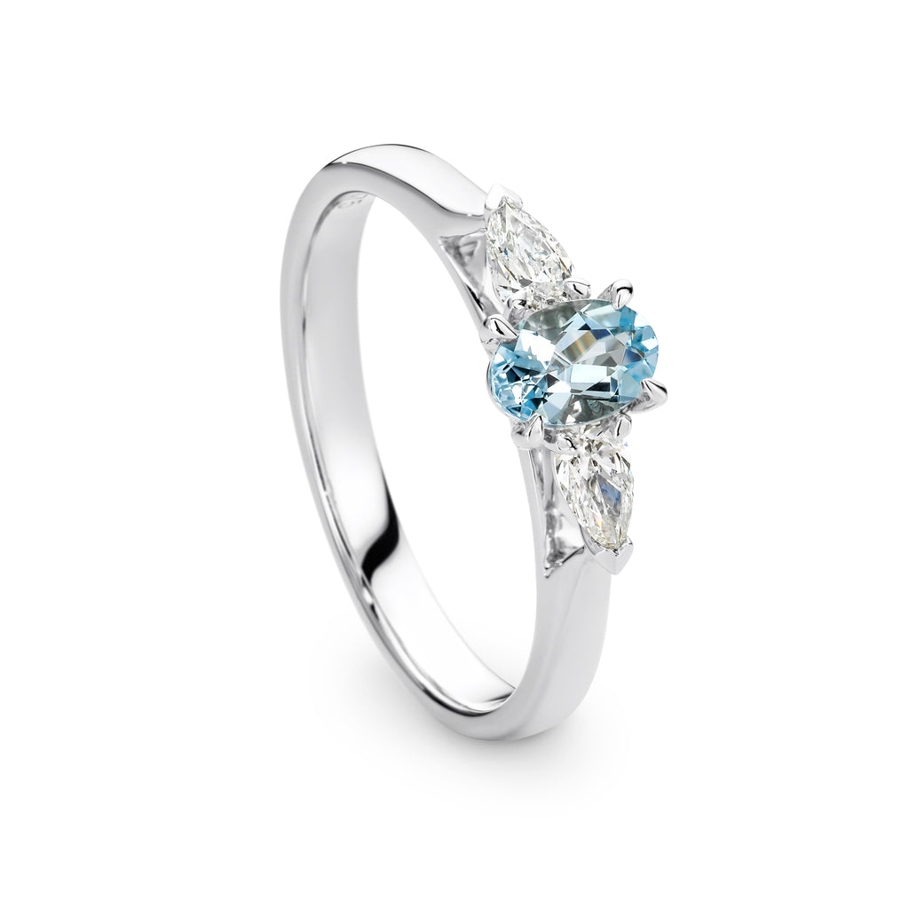 Oval Aquamarine and Pear Shaped Diamond Ring