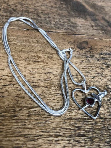 Solid silver hand-made pendant set with almondine garnet with silver chain