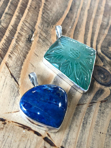 Hand-carved gemstones set in solid silver pendant with chain