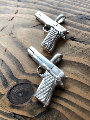 Heavy hand-made solid silver 9mm pistol pendant