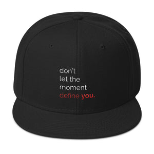 "The ""don't let the moment define you."" Snapback"